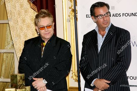 Sir Elton John and Harry Slatkin of President Home Design Limited Brands at the launch of the Elton John Fireside Holiday Collection available at Bath and Body Works, a portion of proceeds will benefit The Elton John Aids Foundation.