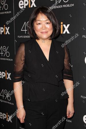 Caroline Suh (Director)