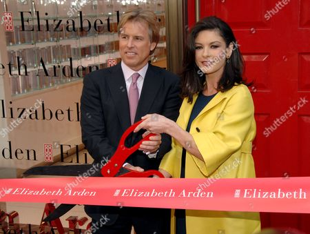Elizabeth Arden Chairman and Chief Executive Officer Scott Beattie and Catherine Zeta-Jones cut the red ribbon