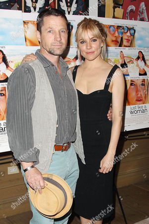 Tim Guinee and Sienna Miller