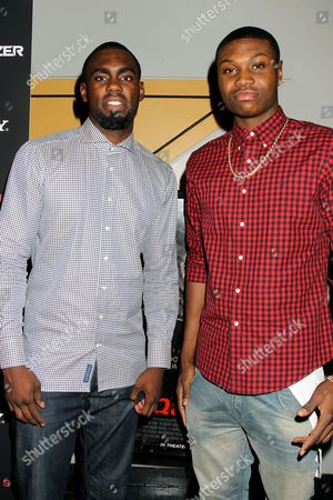 Stock Image of Tim Hardaway Jr. and guest