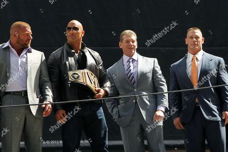 Stock Image of Paul Levesque, Dwayne Johnson, Vince McMahon and John Cena