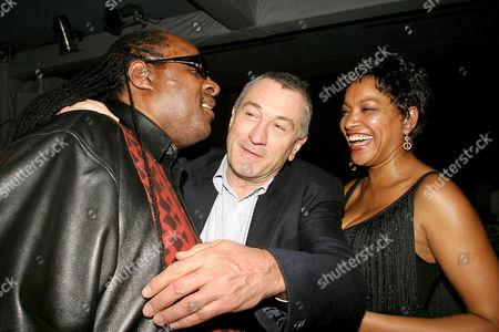 Stevie Wonder and Robert De Niro with girlfriend Grace Hightower