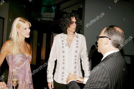 Howard Stern (c) with girlfriend and Jerry Inzerillo