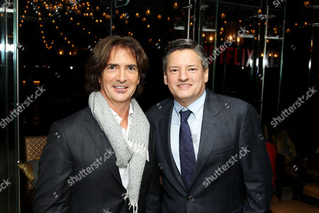 Stock Photo of John Fusco (Co-Creator, Executive Producer) and Ted Sarandos (Netflix Chief Content Officer)