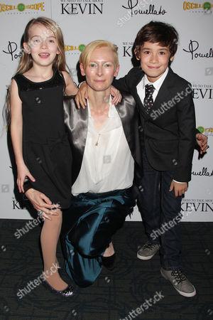 Stock Image of Ashley Gerasimovich, Tilda Swinton and Jasper Newell