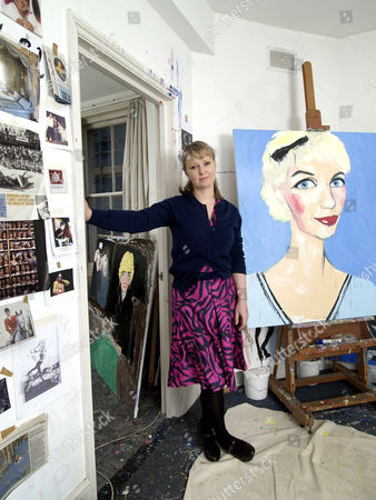 Artist Stella Vine in her home and studio with an unfinished painting of Paula Yates