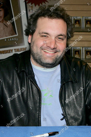Stock Photo of Artie Lang (Howard Stern show) signing copies of his new DVD 'It's the whiskey talking'.