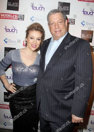 Stock Image of Alyssa Milano and Mitchell Modell (CEO, Modell's)