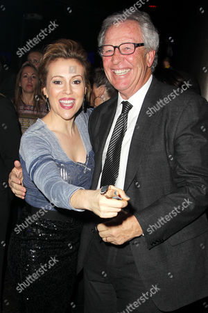 Stock Photo of Alyssa Milano and Morris Goldfarb (CEO, G-III Apparel Group)