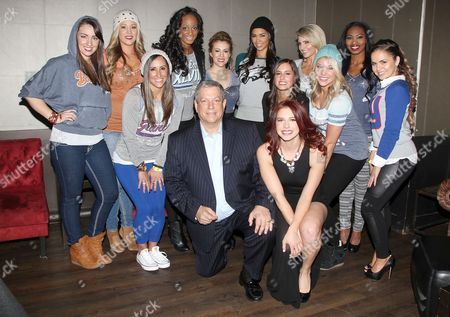 Alyssa Milano, Mitchell Modell (CEO, Modell's Sporting Goods) with models