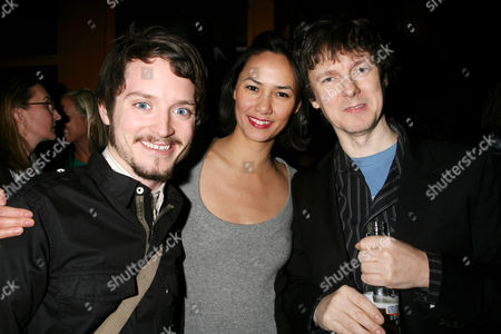 Michel Gondry and Elijah Wood with girlfriend Pamela Racine