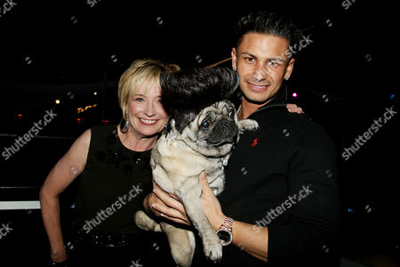 Kate White (Editor-in-Chief Cosmo), Paul DelVecchio (DJ Pauly D) holding Puggy D