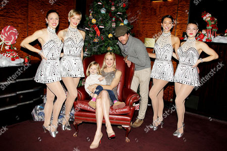Stock Photo of Mathew Settle, daughter Aven Settle, Kelly Rutherford and Rockettes