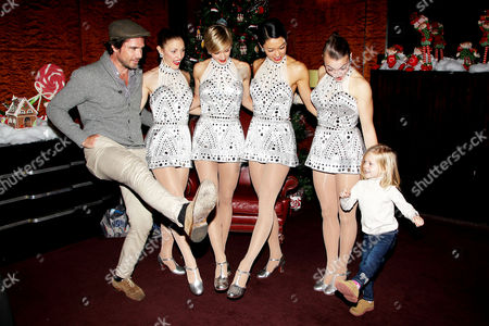 Stock Image of Mathew Settle, daughter Aven Settle and Rockettes