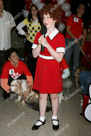 Stock Image of Marissa O'Donnell (Annie). Little orphan Annie (played by Marissa O'Donnell) selected a winning dog to star on stage with her at the theatre at MSG this December. The dog that won the walk on role was Wisky from the Humane Society of New York