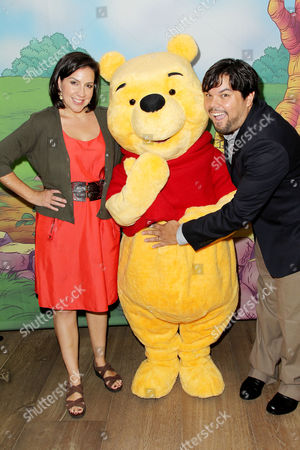 Kristen Anderson-Lopez and Bobby Lopez with Winnie the Pooh