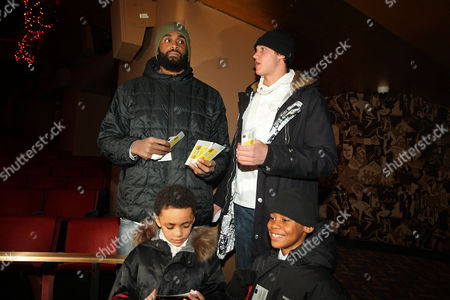 New York Knicks Ronny Turiaf and Danilo Gallinari with kids from the Garden of Dreams Foundation