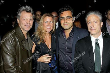 Stock Photo of Jon Bon Jovi, Paola Bahari, Maziar Bahari, Jon Stewart (Dir./Writer/Producer)