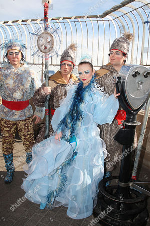 Stock Photo of Cirque du Soleil WINTUK contortionist (Elena Lev) with People from the North