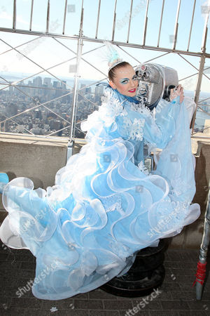 Editorial picture of Cirque du Soleil WINTUK Contortionist on top of the Empire State Building, New York, America - 19 Nov 2010