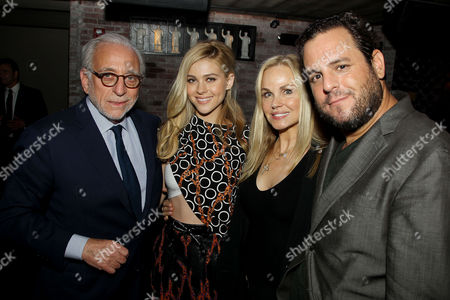 Stock Photo of Nicola Peltz with Parents and Kevin Asch