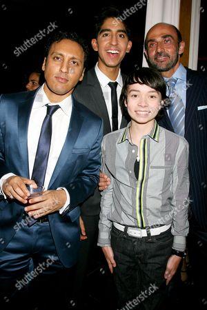 Stock Photo of Aasif Mandvi, Dev Patel and Noah Ringer