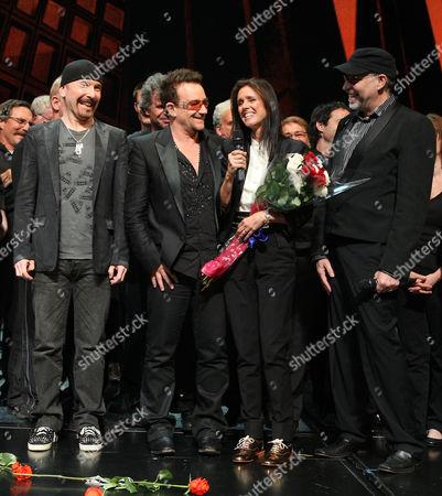 Stock Photo of The Edge, Bono, Julie Taymor and Philip William McKinley