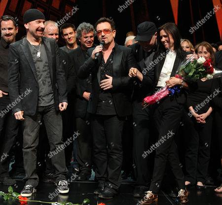 The Edge, Bono, Philip William McKinley and Julie Taymor
