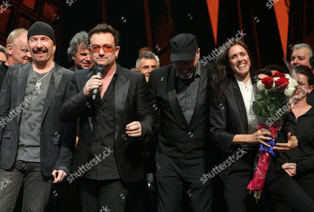 Stock Image of The Edge, Bono, Philip William McKinley and Julie Taymor