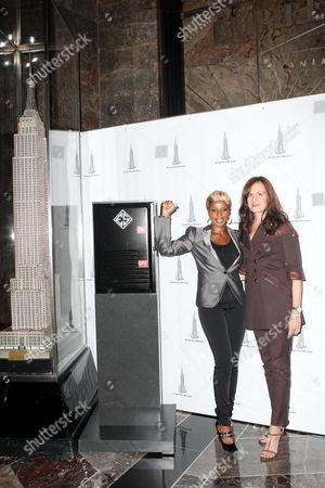 Stock Picture of Mary J. Blige and Daniella Vitale (Gucci America President)