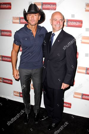 Stock Photo of Tim McGraw and NYC Fire Commissioner Salvatore Cassano