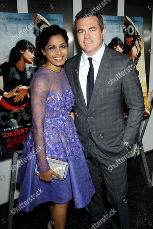 Freida Pinto and Tucker Tooley