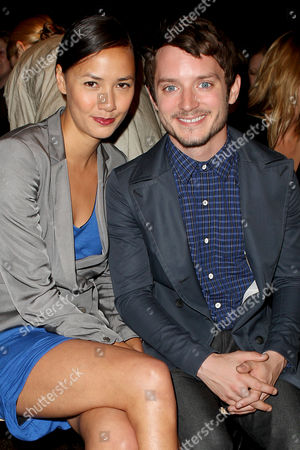 Elijah Wood and Pamela Racine