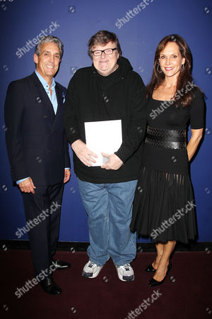 Charles S. Cohen, Michael Moore and Chloe Cohen