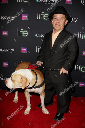 Stock Photo of Shorty Rossi (Pit Boss) with Hercules the dog
