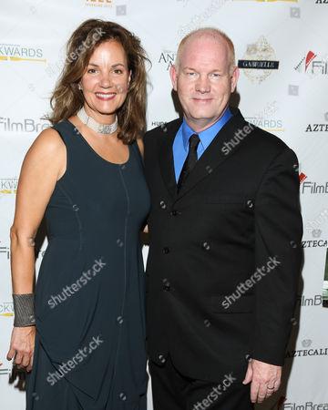 Margaret Colin and Glenn Morshower