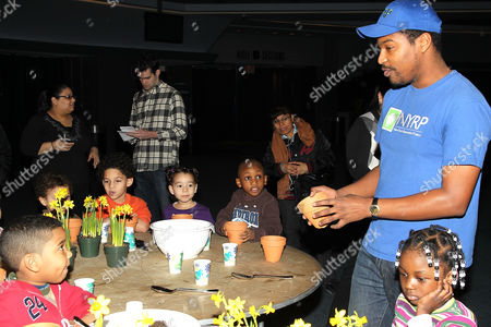 Stock Picture of Omari Washington and children from Garden of Dreams Foundation