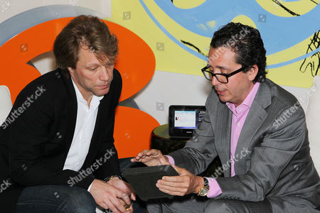 Stock Image of Jon Bon Jovi and Executive Vice Pres.,Chief Financial Officer Sony Robert Wiesenthal