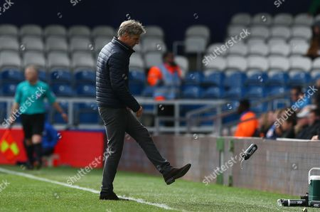 Charlton Athletic manager Jose Riga kicks a water bottle in frustration during the Sky Bet Championship match between QPR and Charlton Athletic played at Loftus Road, London on April 9th 2016
