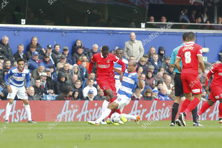 Charlton Athletic's Yaya Sanogo and Queens Park Rangers Karl Henry during the Sky Bet Championship match between QPR and Charlton Athletic played at Loftus Road, London on April 9th 2016