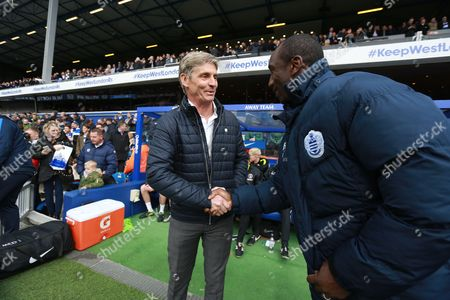 Charlton Athletic's manager Jose Riga  and Queens Park Rangers manager Jimmy Floyd Hasselbainkduring the Sky Bet Championship match between QPR and Charlton Athletic played at Loftus Road, London on April 9th 2016