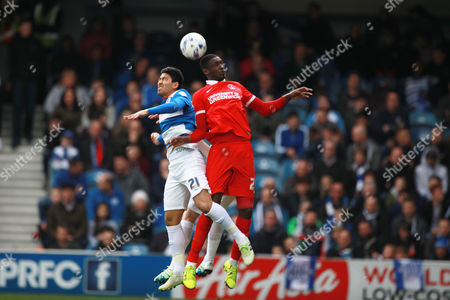 Queens Park Rangers Massimo Luongo and Charlton Athletic's Yaya Sanogo during the Sky Bet Championship match between QPR and Charlton Athletic played at Loftus Road, London on April 9th 2016