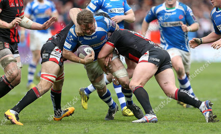 Stock Picture of Lewis Evans of Newport Gwent Dragons is tackled by Paul Doran-Jones and Darren Dawiduik of Gloucester.