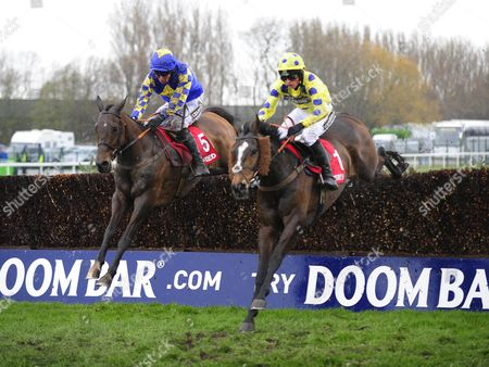 Aintree MAGGIO & James Reveley (left) jump the 2nd last to win the Betfred Handicap Steeplechase from VIRAK & Harry Cobden (right)