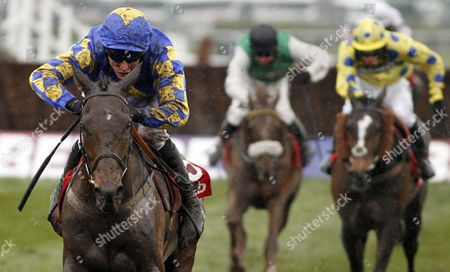 Stock Image of MAGGIO (James Reveley) wins The Betfred Handicap Chase Aintree