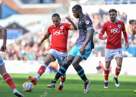 Bristol City forward Peter Odemwingie (27) and Sheffield Wednesday striker Lucas Joao (18) challenge for the ball during the Sky Bet Championship match between Bristol City and Sheffield Wednesday at Ashton Gate, Bristol