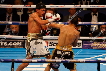Stock Photo of JAMIE McDONNELL (white shorts) from the UK during his victory over FERNANDO VARGAS (Black shorts) of Mexico during the WBA World Bantamweight title at the O2 Arena, London on April 9th 2016