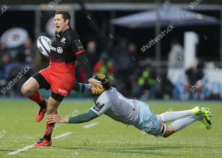 Alex Goode of Saracens gets away from Victor Matfield of Northampton