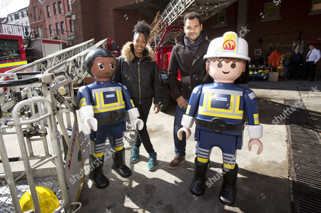 V presenters Angellica Bell and husband Michael Underwood hang out with life-sized Playmobil figures